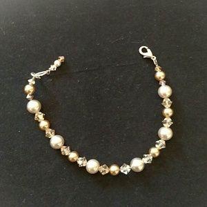 Beautiful tan crystal and pearl bracelet.